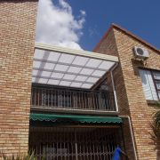 Best awnings for windy areas are retractable ones that have the fabric attached at the front bar and the structure wall, soffit/eave or roof. Although the awning may withstand a greater wind force, flying debris can still cause damage.