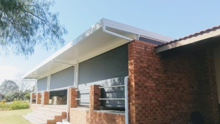 Awning Warehouse - An awning roof with track blinds is an addition to your property